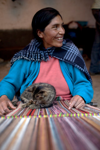 Quechua weaver and cat- a timeless tradition