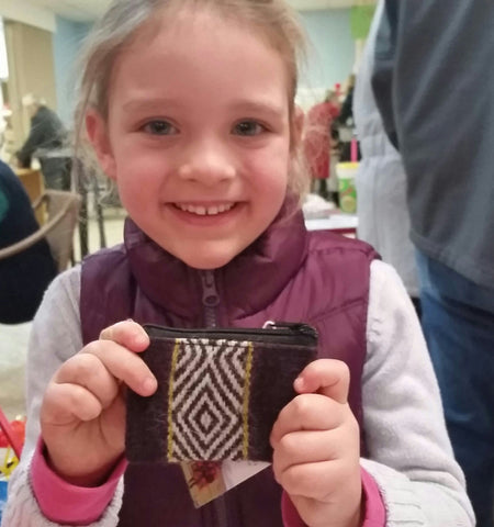 This little girl purchased 3 of the small purses, one for her mom, grandma and for herself!