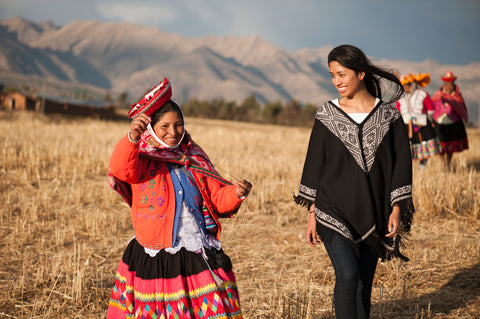 Young Andean woman demonstrating spinning technique
