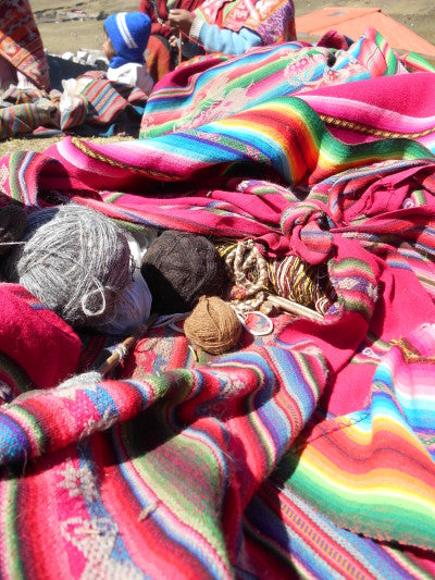 After traveling from distances near and far, the weavers in Chaullacocha all gather together with their colorful balls of naturally dyed yarn to begin working