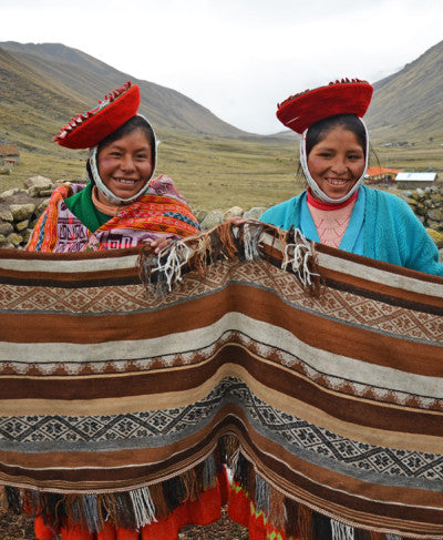 Santusa Cjuro Castille (left) and Demesia Sinchi Echami (right) worked together to create this stunning Alejandro poncho! Because of the size and time involved in weaving ponchos, the women work in pairs with friends and relatives of their communities