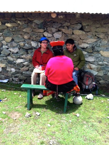 Evaluation Research Intern Harrison works with Adrian, a friend and Spanish-Quechua translator, to complete one of the team's final interviews in Chaullacocha. (Photo credit Dana Blair)
