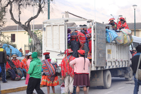 Preparing for the trip up to Chaullacocha! Here, the food truck is loading up with goods and people in the plaza at Ollantaytambo. (Photo credit Harrison Ackerman)
