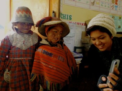 "Taking an iPhone ""selfie"" with 2 kids in the schoolhouse of Chaullacocha. Photo by Olivia Campus"