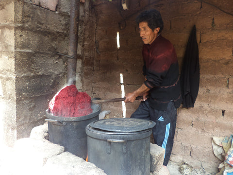 Martín lifting out the freshly dyed red yarn, our first batch of the day