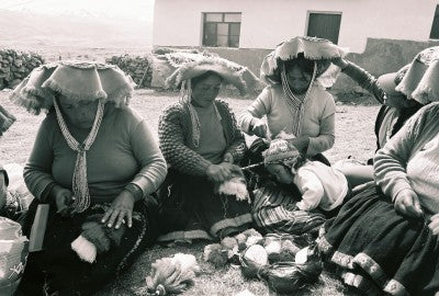 Weavers from the community of Uppis. Photography by Giulia Grassi