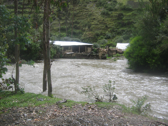The heavy rains caused the river to swell and overflow, creeping up towards property lines