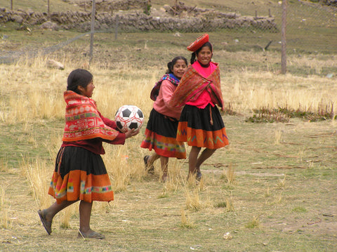 Not to be outdone, the girls in Rumira Sondomayo have a go. There is a big women's football game every Sunday in this village.