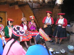 Women talking to Chincheros weavers