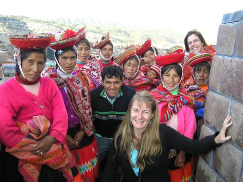 Blog author Ariana Svenson, with Threads of Peru Community Liasion Officer Urbano Huayna, volunteer Calina Ellwand and the women of the communities on top of the statue of Inca Pachacutec.