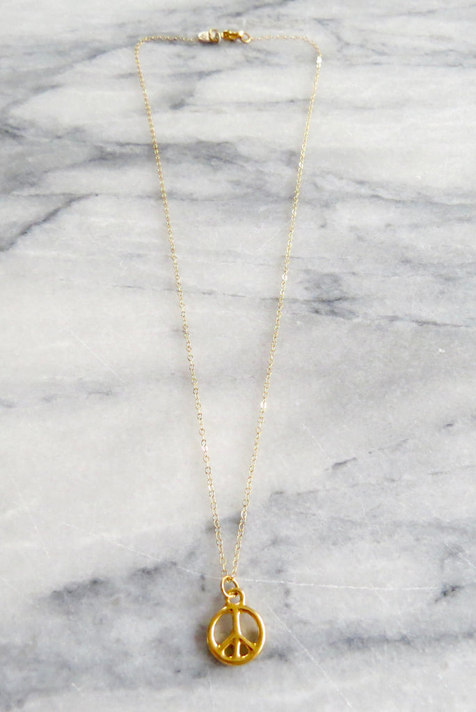 gold peace sign necklace