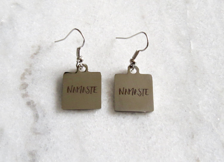 silver namaste earrings