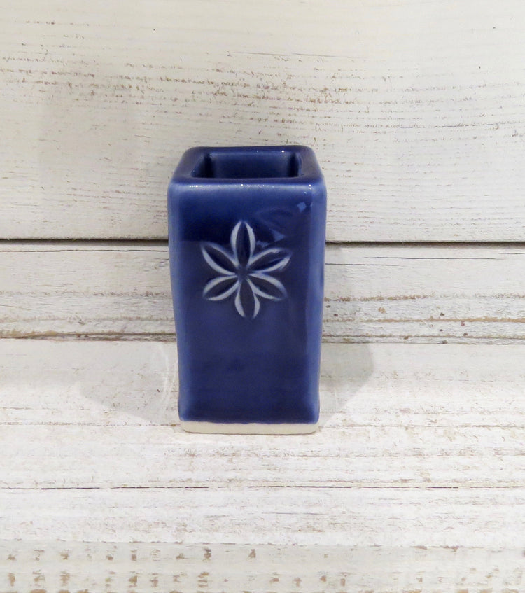dark blue flower bud vase