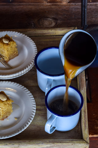 Pouring Turkish coffee to have with our semolina cake.