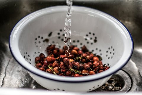 Washing rosehips, Falcon enamel colander.