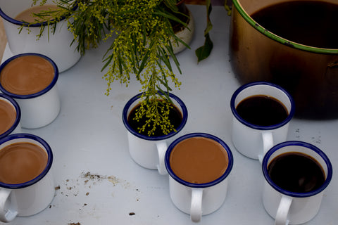 Cardamom coffee served in Falcon enamel mini mugs.