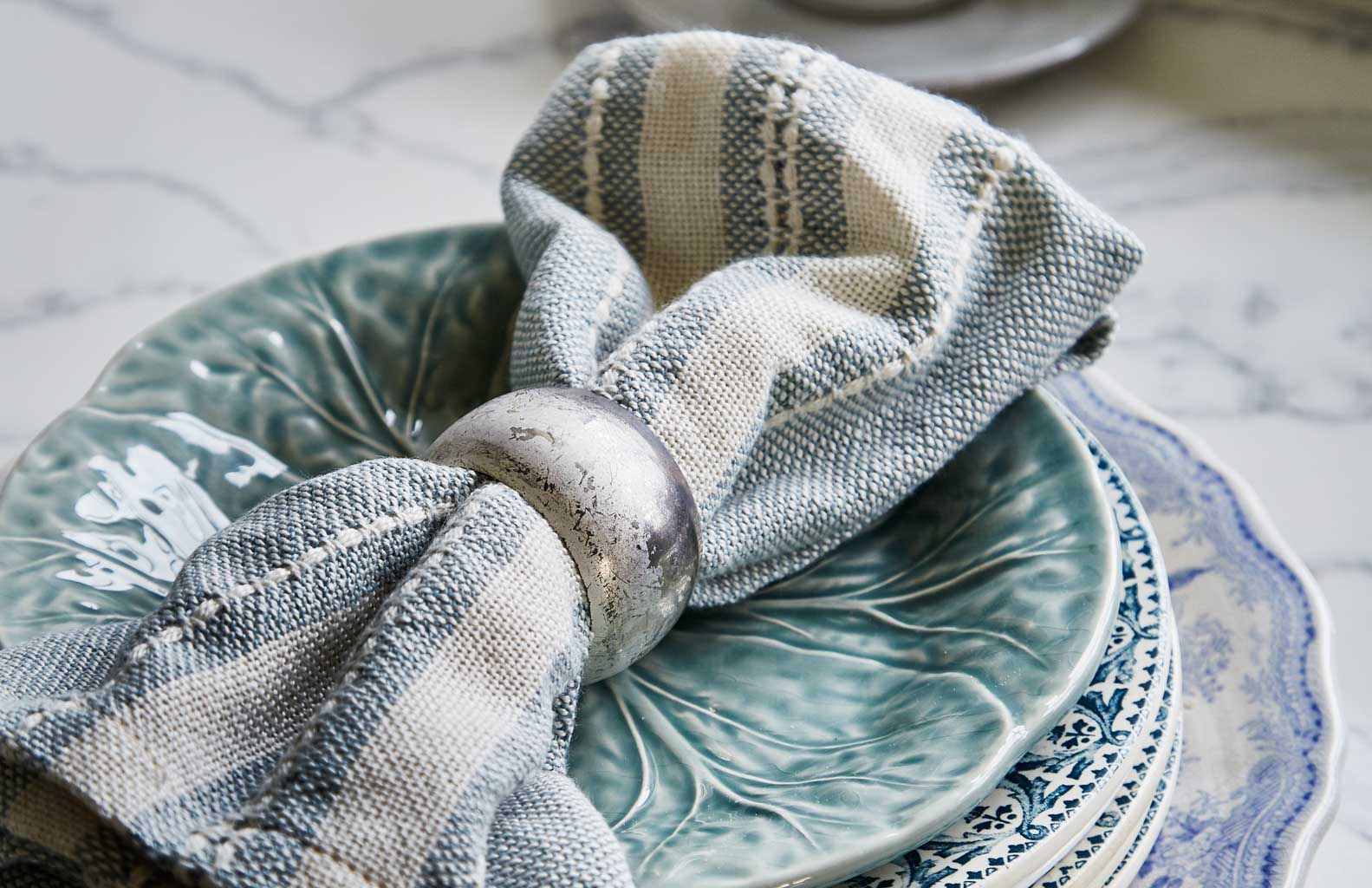 marseille blue and white napkins on saucer
