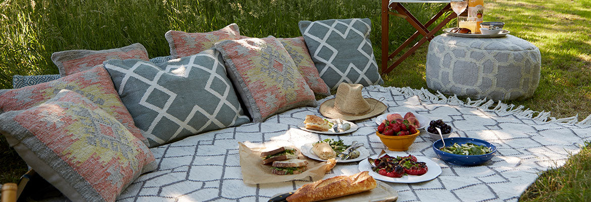 tangier medina rug with weaver green cushions on an outdoor picnic