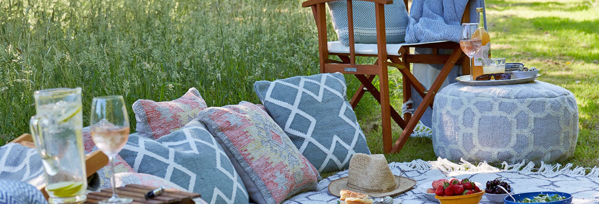 Kasbah Ink Footstool with Weaver Green outdoor cushions and rug