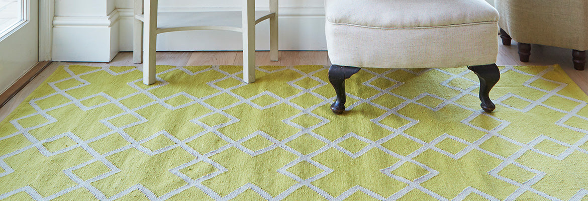 Large Juno rug in gooseberry with chair legs