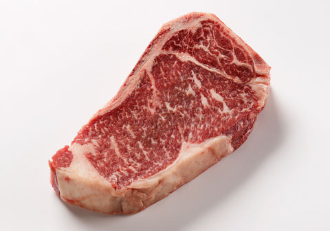 **U.S.D.A. Prime Grade Beef New York Strip Steaks - Bone-in   $14.99lb