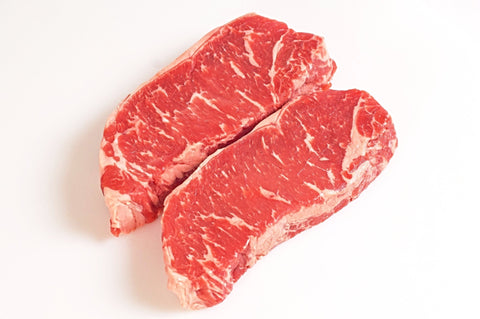 **Beef New York Strip Steaks  Bone-in Family Pack  $10.99lb