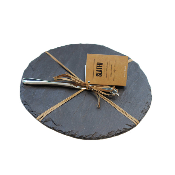 A slate round cheese board handcrafted by Slated Ireland.
