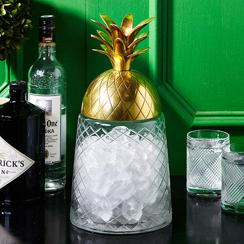 Two's Company Gold Pineapple Covered Glass Jar. Perfect to house ice for your cocktail bar.