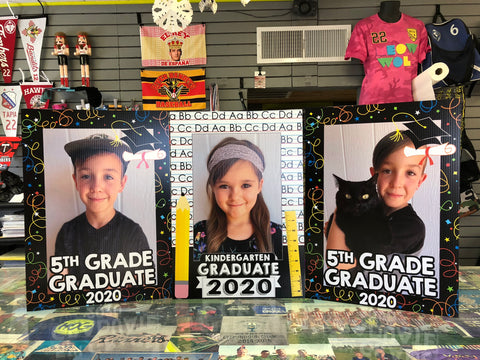 Kindergarten and 5th grade graduate signs