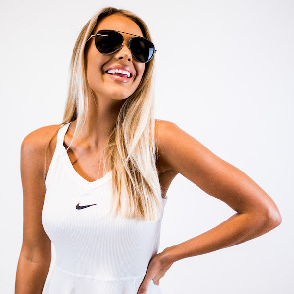 woman in aviator sunglasses