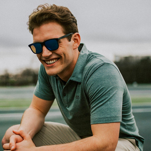 man smiling in wayfarer sunglasses