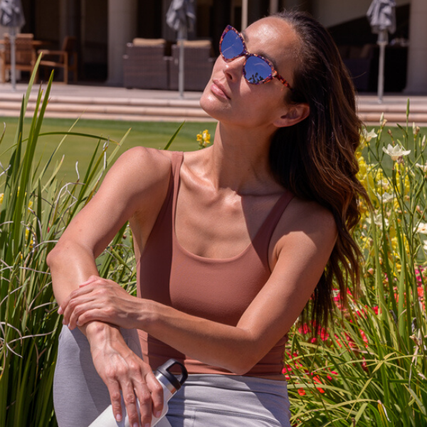 woman in yoga gear and sunglasses