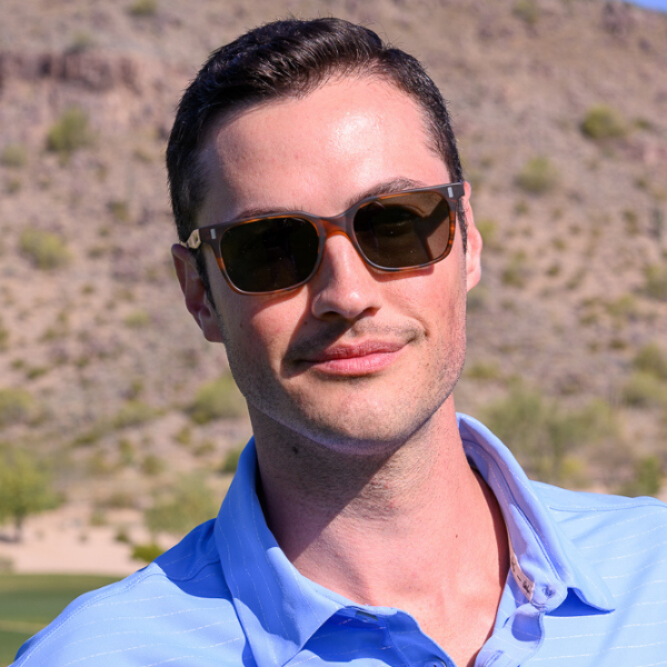 man wearing whisky colored frames