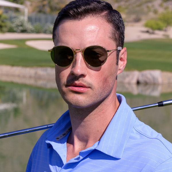 man on golf course in round sunglasses