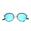 Folded front view of circle blue sunglasses with black and marble frame