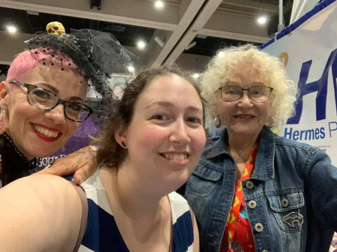 A selfie of Kaz (Mother Goth Rhymes), Sabrina (HP's Managing Editor), and Trina Robbins (Babes in Arms)!