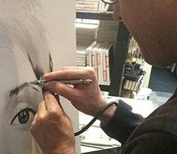 jason airbrushing picture of an eye