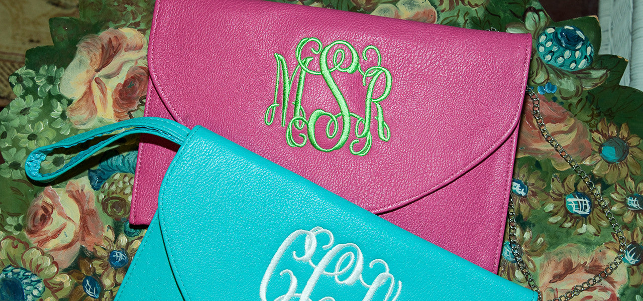 Handbag clutch with attachable handles and chaings embroidered with initials or name or monogram.
