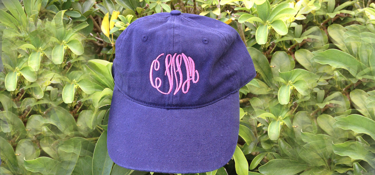 Trucker caps and baseball caps with monogram or name embroidered on front.