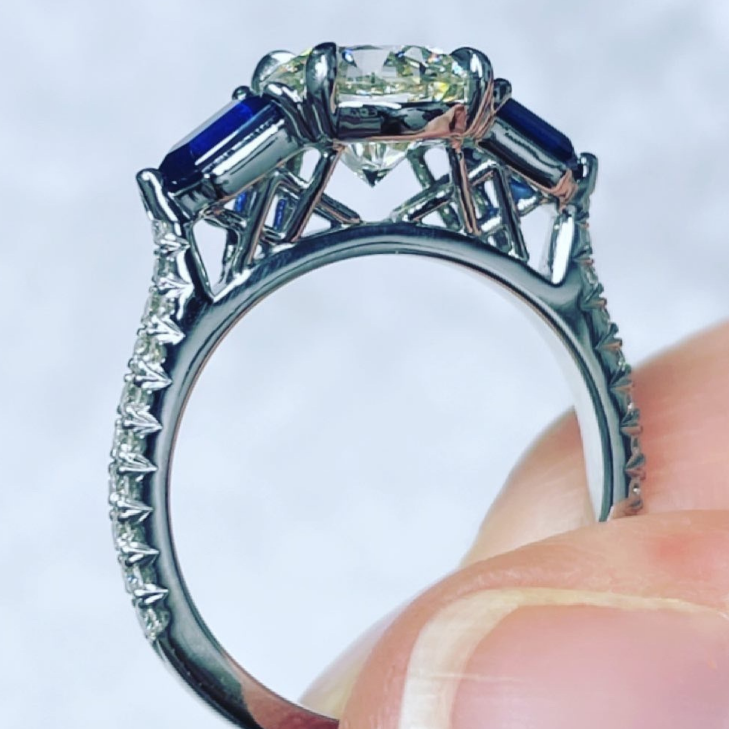 Top view platinum engagement ring with diamond and sapphires