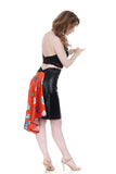 the signature skirt in leatherette and fire engine flowers - Poema Tango Clothes: handmade luxury clothing for Argentine tango