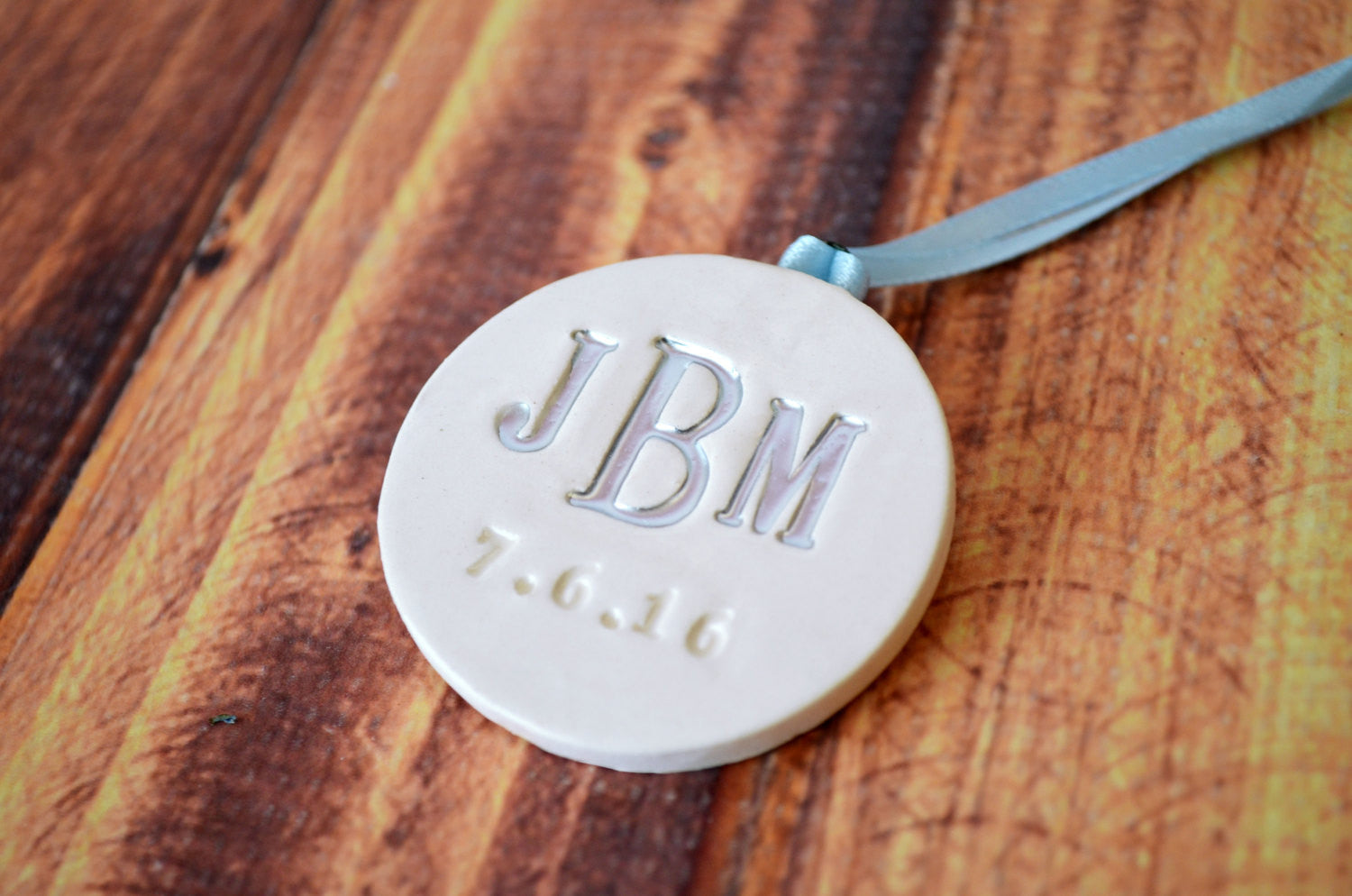 large round personalized wedding bouquet charm with monogram and date gift boxed