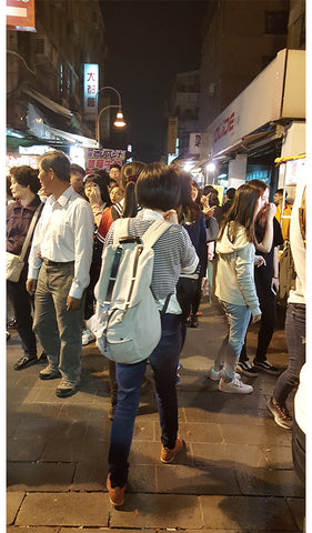 Team walking on the night markets