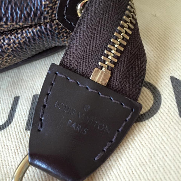 Louis Vuitton Eva Clutch in Damier Ebene Canvas