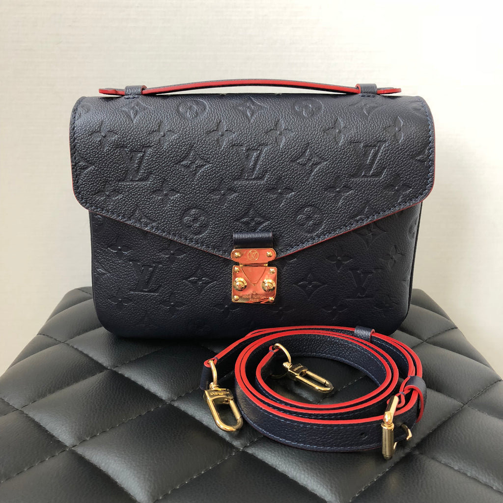 7e386aacdefb Louis Vuitton Monogram Empreinte Leather Pochette Métis in Marine Roug
