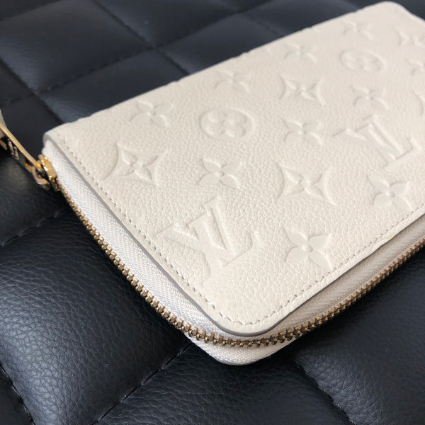 Louis Vuitton Monogram Empreinte Neige/Ivory Portefeuille Secret Long Wallet