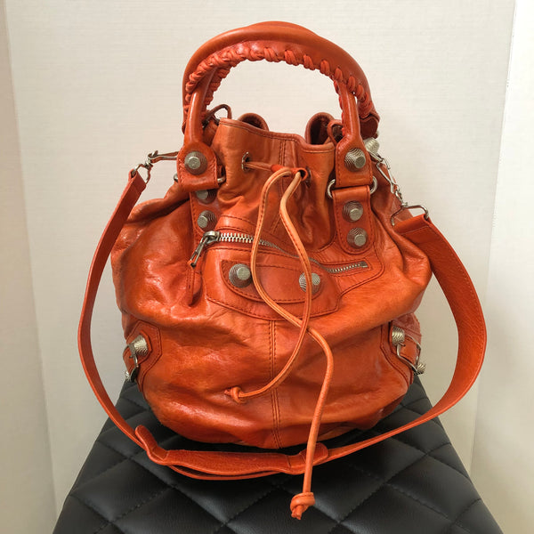 Balenciaga Orange Pompon Bucket Crossbody Bag