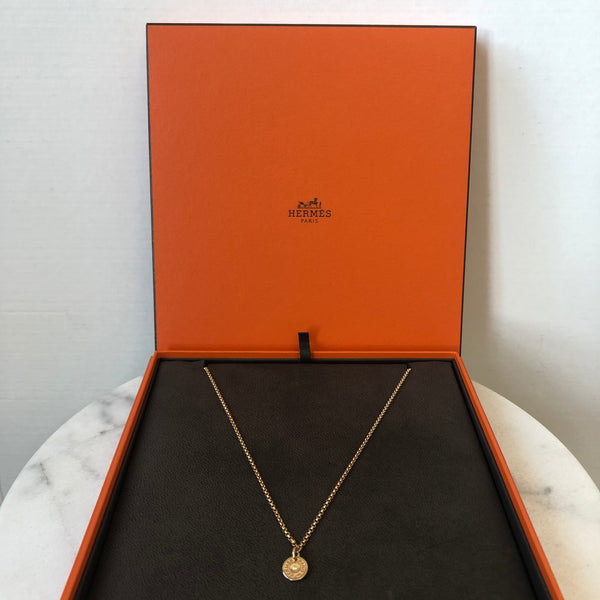 "Hermes Gambade pendant with ""Clou de Selle"" motif in rose gold set with 1 diamond"