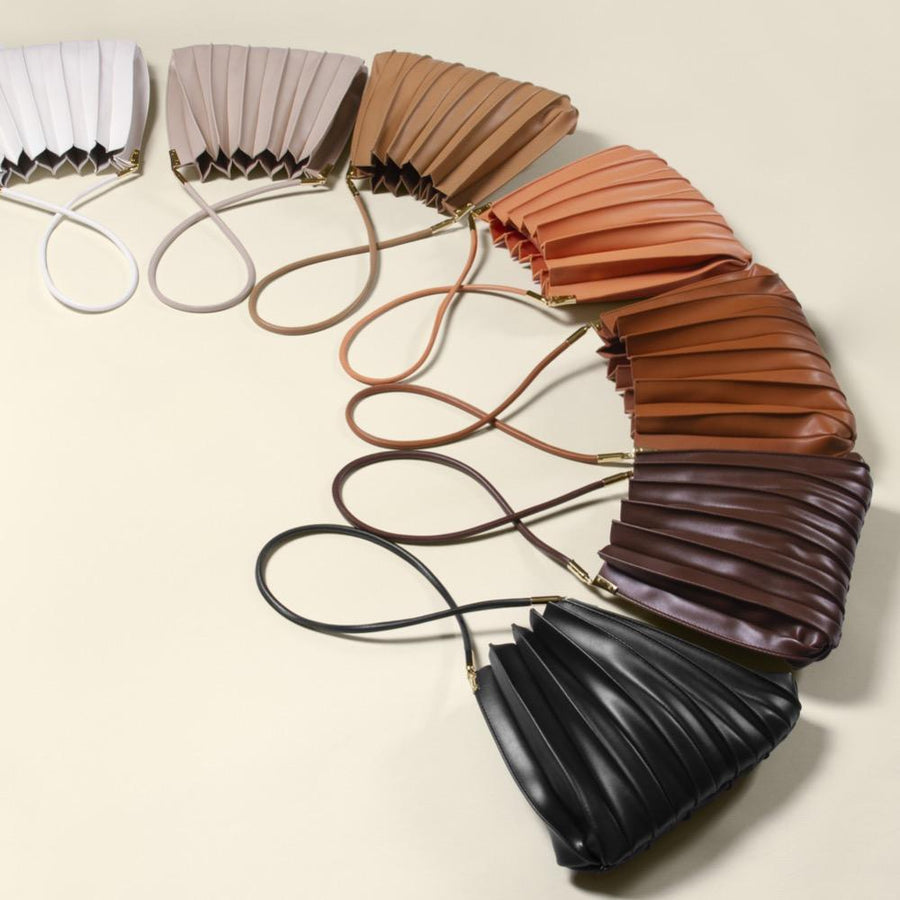 Melie Bianco Carrie Pleated Luxury Vegan Leather Shoulder Bag in Ivory, Bone, Taupe, Peach, Tan, Chocolate, and Black.