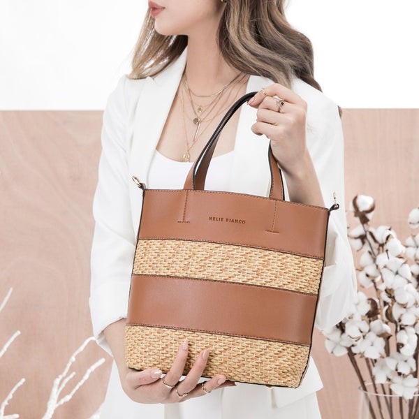 vegan, cruelty free, handbag, bag, purse, faux leather, animal friendly, sustainable fashion, shoulder bag, tote, rattan, woven, saddle, brown, cognac, tan, two tone, color block, beach, summer